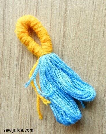 haciendo borlas con hilo de bordar