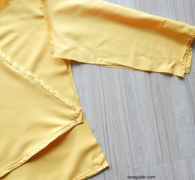 Cómo coser la parte superior del abrigo